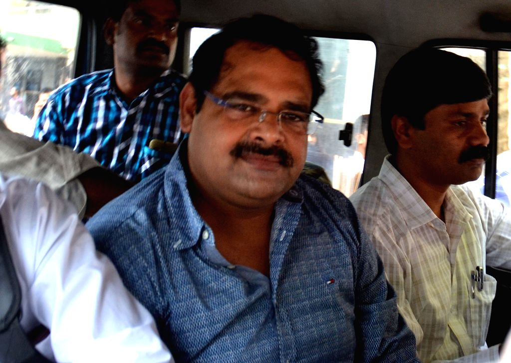 Congress legislator and minelord Anil H Lad being taken to be produced at a Bengaluru Court, in connection with the illicit exports, in Bengaluru on July 16, 2015.