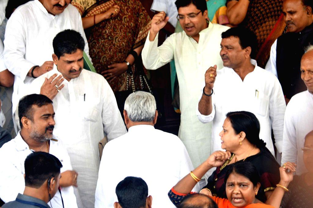 Congress legislators stage a demonstration as Bihar Chief Minister and JD-U legislator Nitish Kumar arrives at the state assembly, in Patna on July 24, 2018. - Nitish Kumar