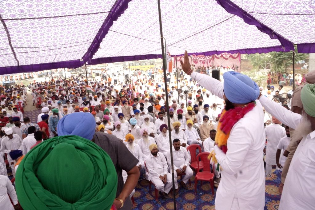Congress' Lok Sabha candidate from Amritsar, Gurjeet Singh Aujla waves at supporters during a public rally ahead of the 2019 Lok Sabha elections, in Amritsar on May 11, 2019. - Gurjeet Singh Aujla