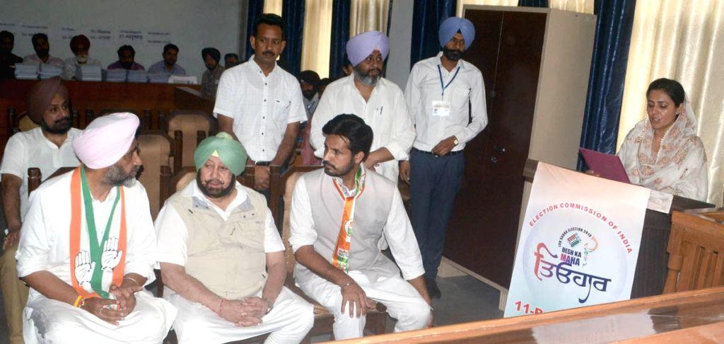 Congress Lok Sabha candidate from Bathinda, Amarinder Singh Raja accompanied by Punjab Chief Minister Amarinder Singh and Finance Minister Manpreet Singh Badal at District Magistrate office ... - Amarinder Singh Raja and Manpreet Singh Badal