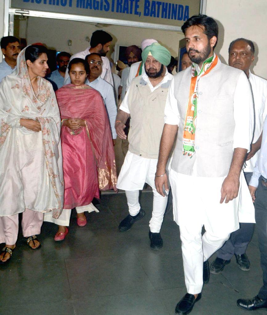 Congress Lok Sabha candidate from Bathinda, Amarinder Singh Raja accompanied by Punjab Chief Minister Amarinder Singh, arrives to file his nomination for the forthcoming Lok Sabha polls, in ... - Amarinder Singh Raja