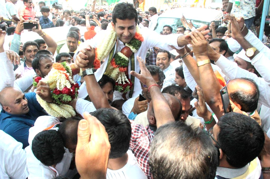 Congress' Lok Sabha candidate from Bengaluru Central, Rizwan Harshad being welcomed by supporters on his arrival to file his nomination for 2019 Lok Sabha elections in Bengaluru, on March ...