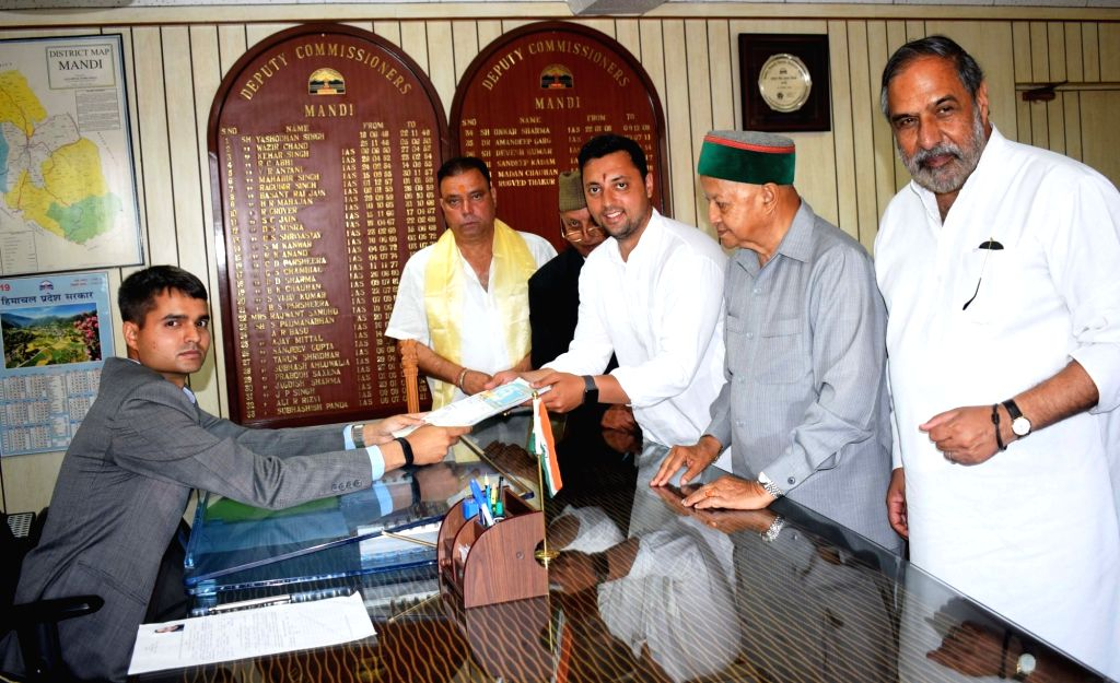 Congress Lok Sabha candidate from Mandi, Ashray Sharma accompanied by senior Congress leaders Virbhadra Singh and Anand Sharma, files his nomination for the forthcoming Lok Sabha polls, in ... - Ashray Sharma, Virbhadra Singh and Anand Sharma