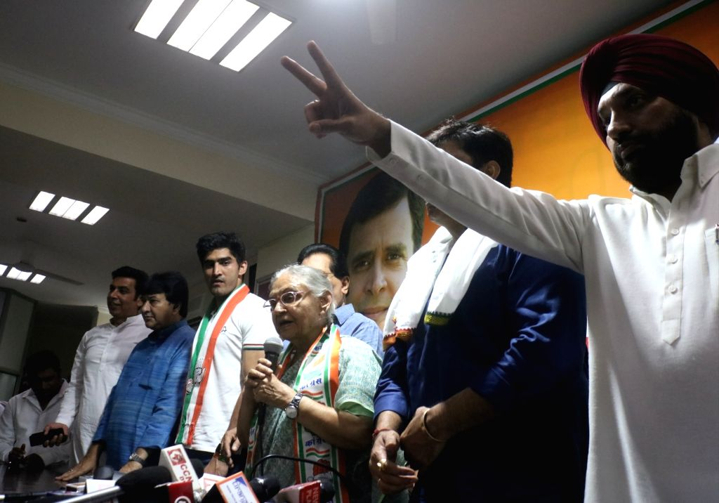 Congress' Lok Sabha candidate from North East Delhi - Sheila Dixit accompanied by other candidates from the party Vijender Singh (South Delhi), Rajesh Lilothia ( North-West Delhi) and ... - Sheila Dixit, Vijender Singh and Arvinder Singh Lovely