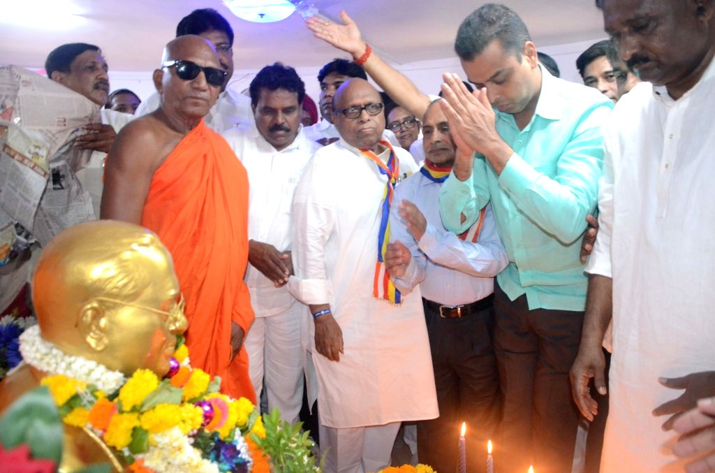 Congress' Lok Sabha candidate from South Mumbai, Milind Deora accompanied by party leader Eknath Gaikwad, pays homage to B.R. Ambedkar on his birth anniversary in Mumbai, on April 14, 2019.