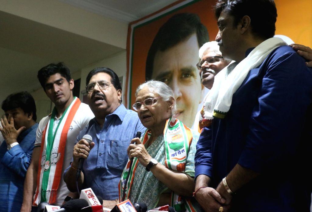 Congress' Lok Sabha candidates from Delhi - Sheila Dixit (North East Delhi) accompanied by Vijender Singh (South Delhi), Mahabal Mishra (West Delhi) and Rajesh Lilothia ( North-West Delhi) ... - Sheila Dixit, Vijender Singh and Mahabal Mishra