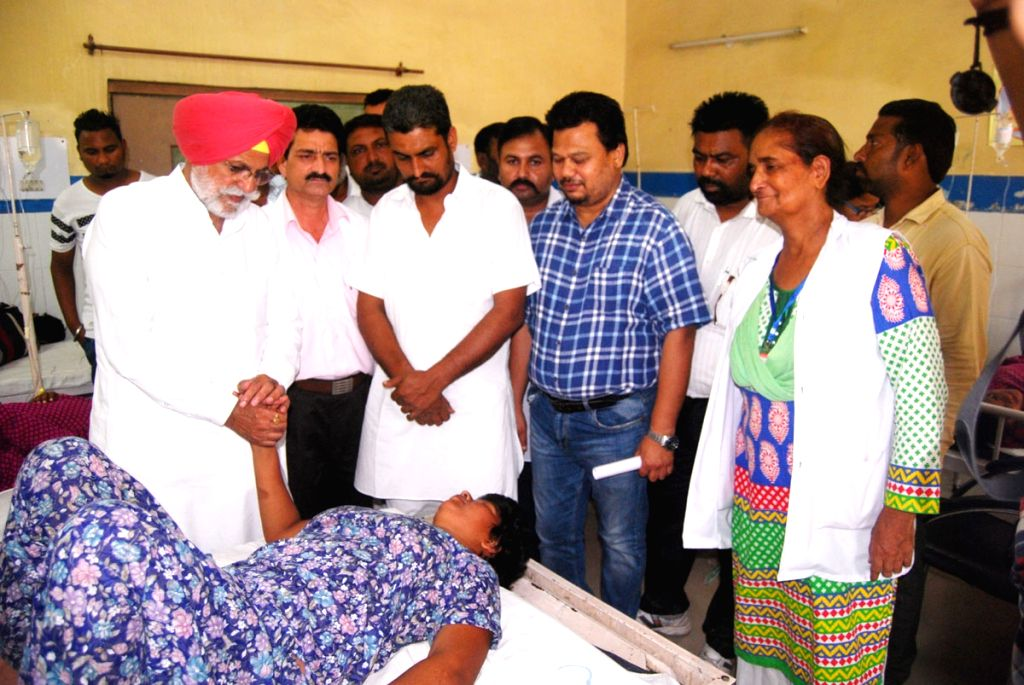 Congress MLA from Kapurthala Rana Gurjeet Singh visits inmates of a home for mentally challenged children who fell ill after consuming poisonous food in Punjab's Kapurthala on Aug 2, 2016.