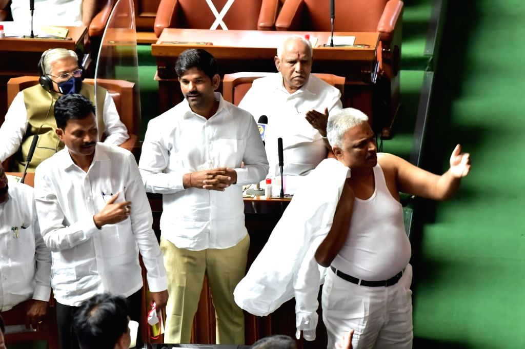 Congress MLA in Karnataka removes his shirt inside Assembly