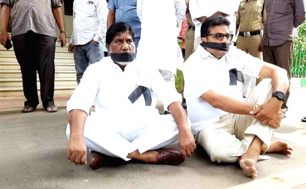 Congress MLAs Mallu Bhatti Vikramarka and Sridhar Babu stage a demonstration against the 12 party MLAs in Telangana who met the state Assembly Speaker urging him to merge the Congress ...