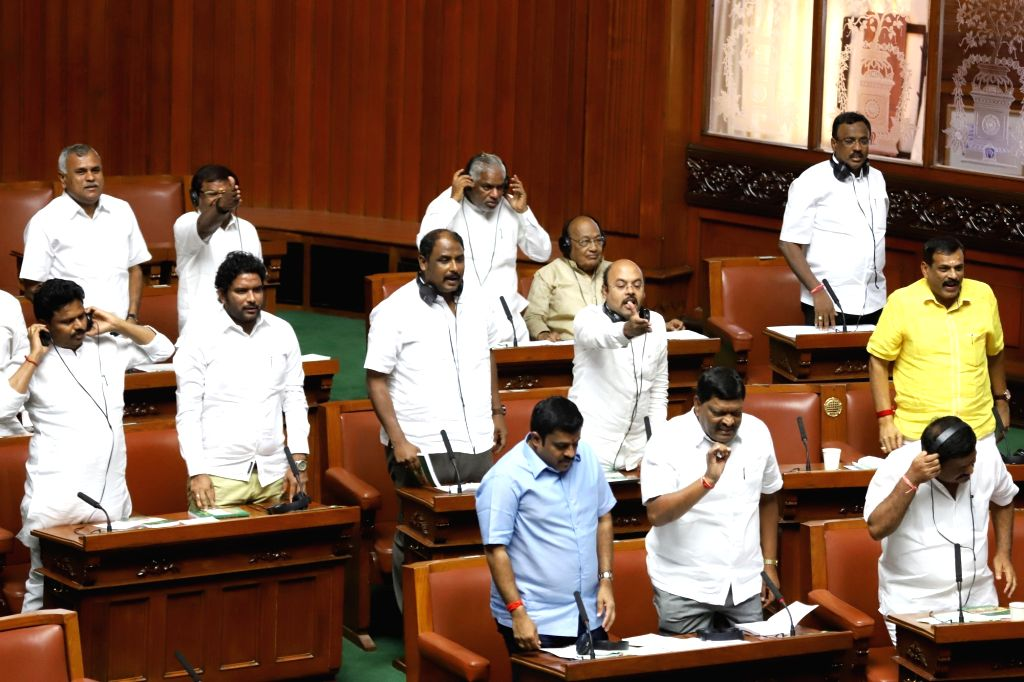 Congress MLAs protest in Karnataka Legislative Assembly, in Bengaluru on July 19, 2019. Karnataka Assembly session resumed on July 19 in Bengaluru to continue the debate on the confidence ... - H.