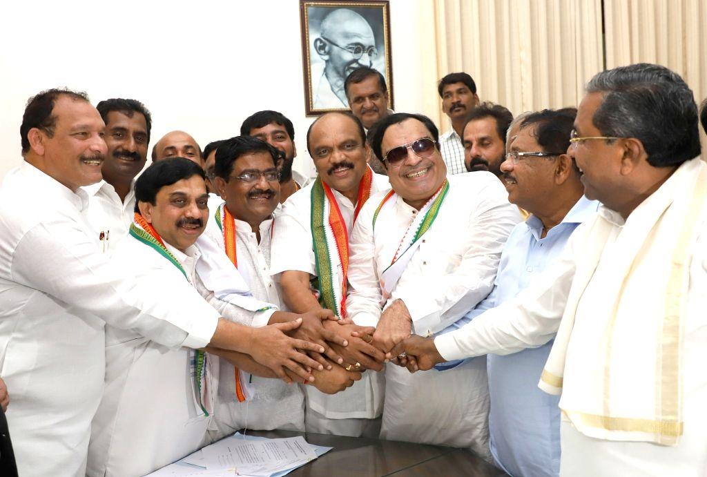 Congress MLC candidates C M Ibrahim, K Govinda Raju, Arvind Kumar Arali and K. Harish being greeted by Congress leaders Siddaramaiah and G Parameshwar during the filing of their ... - Arvind Kumar Arali