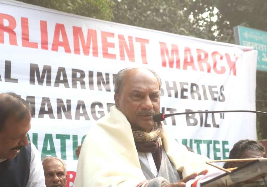 Congress MP AK Antony addresses fishermen from Kerala during their protest against the National Marine Fisheries (Regulation and Management) Bill 2019, in New Delhi on Dec 12, 2019.