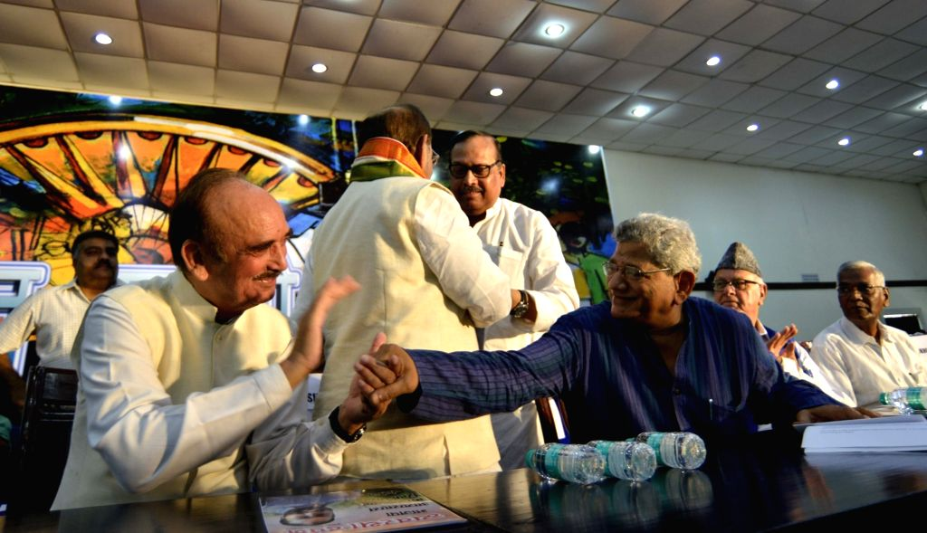 Congress MP Ghulam Nabi Azad interacts with CPI(M) general secretary Sitaram Yehchury during 'Sajha Virasat Bachao' (Save Composite Culture) conference in New Delhi on Aug 17, 2017.