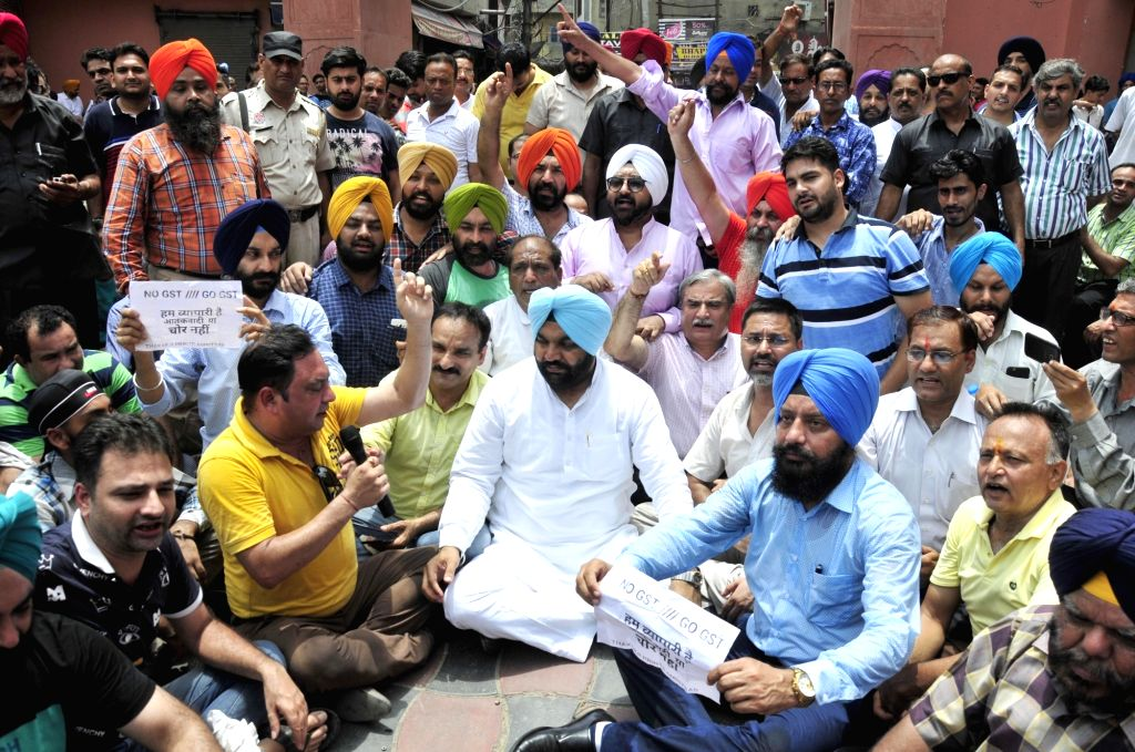 Congress MP Gurjeet Singh Aujla joins traders protesting against GST in Amritsar, on July 6, 2017. - Gurjeet Singh Aujla