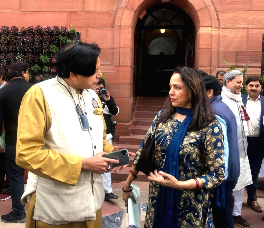 Congress MP Shashi Tharoor in a conversation with BJP MP Hema Malini outside the Lok Sabha during the Budget Session of Parliament, in New Delhi on Feb 10, 2020. - Shashi Tharoor and Hema Malini