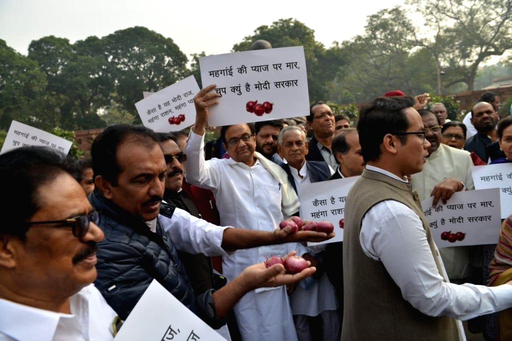 Congress MPs protesting against the price rise of onion at Parliament House in New Delhi on  Dec. 5, 2019.
