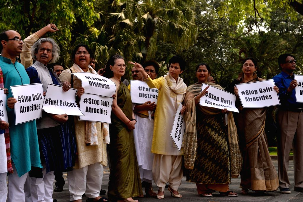 Congress MPs Sonia Gandhi and Kumari Selja along with other opposition legislators stage a demonstration at Parliament in New Delhi on April 5, 2018. - Sonia Gandhi