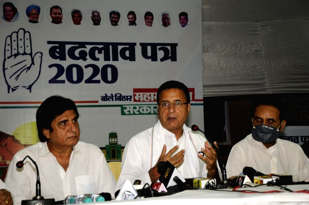 Congress national general Secretary Randeep Singh Surjewala accompanied by Bihar party in-charge Shaktisinh Gohil and senior leader Raj Babbar, addresses a press conference after releasing the ... - Randeep Singh Surjewala