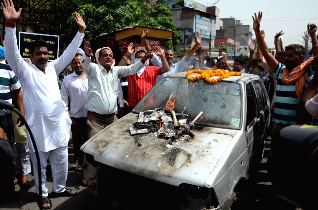 Congress Party activists and supporters shout slogans during a demonstration to protest against the central government decision to hike fuel price  in Amritsar on Friday, 11 June, 2021.