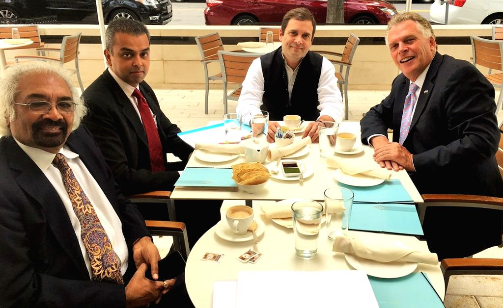 Congress Party Vice President Rahul Gandhi met Virginia Governor Terry McAuliffe, right, on Monday, Sept. 18, 2017, in the Washington area. Seen with them are Sam Pitroda, the chairman of the party's ... - Rahul Gandhi