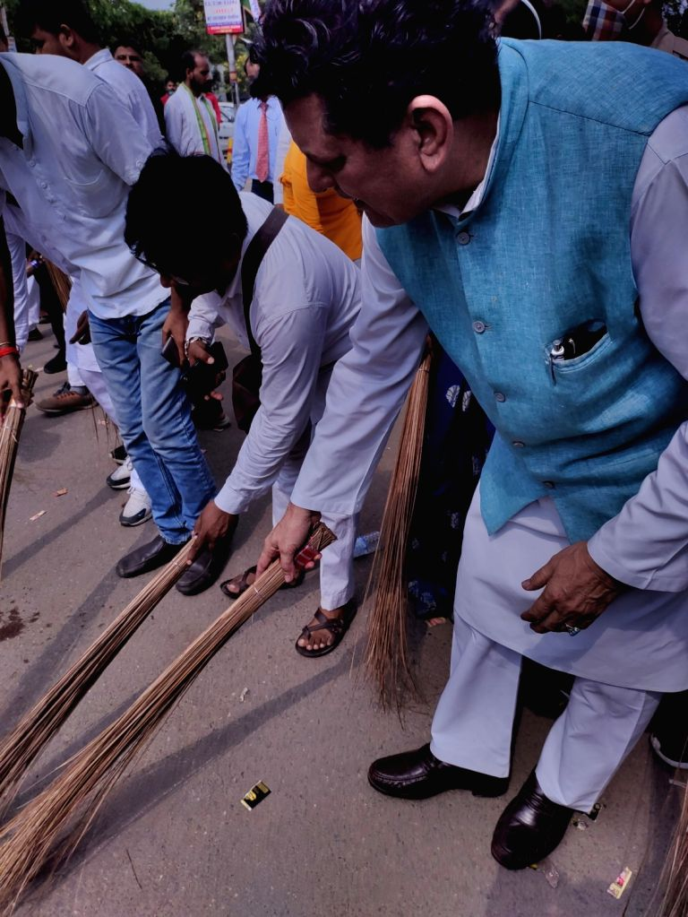 Congress Party workers brooms the road outside a guest house where Party General Secretary Priyanka Gandhi Vadra detained by UP police  while she was on the way to Lakhimpur Kheri  in Lucknow on ...