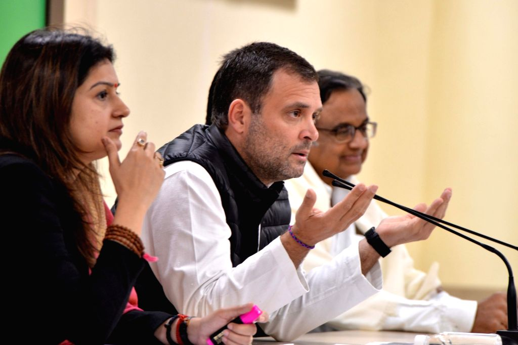 Congress President Rahul Gandhi accompanied by party leaders P. Chidambaram and Priyanka Chaturvedi, addresses a press conference in New Delhi on Feb 8, 2019. - Rahul Gandhi