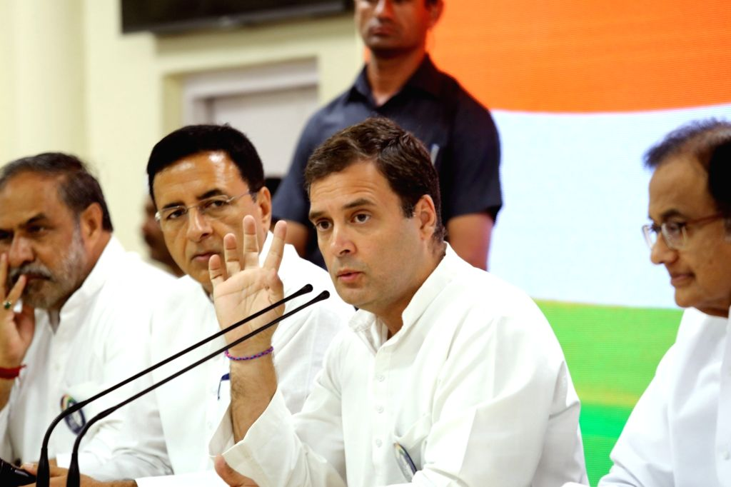 Congress President Rahul Gandhi accompanied by party leaders Anand Sharma, Randeep Singh Surjewala and P. Chidambaram, addresses a press conference at the party's headquarter, in New Delhi ... - Rahul Gandhi, Anand Sharma and Randeep Singh Surjewala
