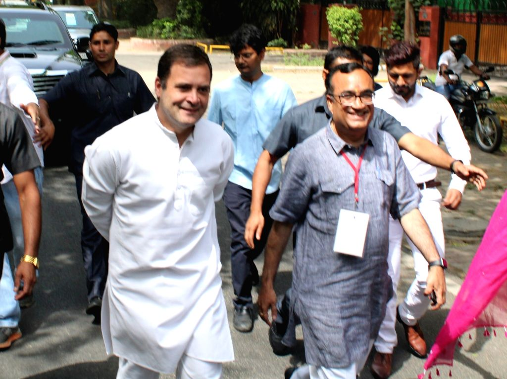 Congress President Rahul Gandhi accompanied by party leader Ajay Maken arrives to cast his vote during the sixth phase of 2019 Lok Sabha elections, in New Delhi on May 12, 2019. - Rahul Gandhi