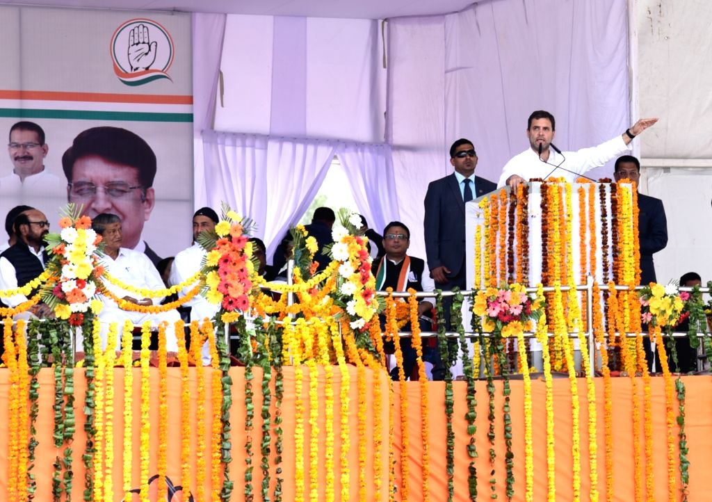 Congress President Rahul Gandhi addresses at a party rally in Dehradun, on March 16, 2019. Also seen Congress leader Harish Rawat. - Rahul Gandhi