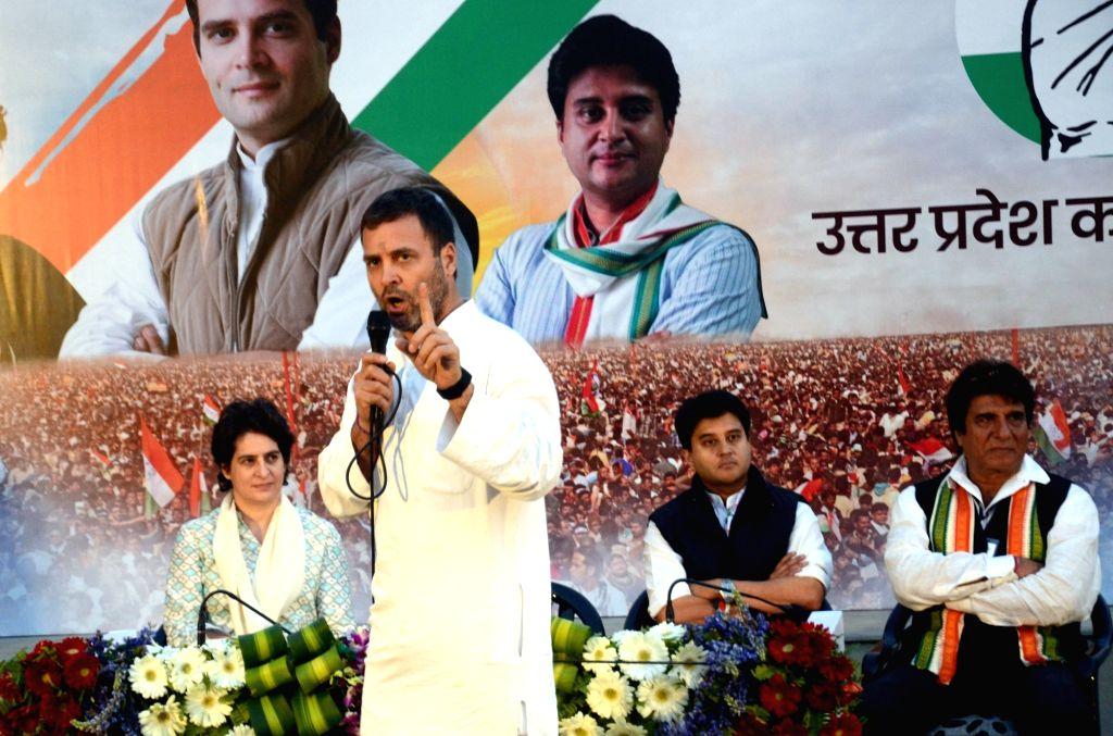 Congress President Rahul Gandhi addresses party workers in Lucknow on Feb 11, 2019. Also seen Congress leaders Priyanka Gandhi Vadra, Raj Babbar, Jyotiraditya Scindia. - Rahul Gandhi and Priyanka Gandhi Vadra