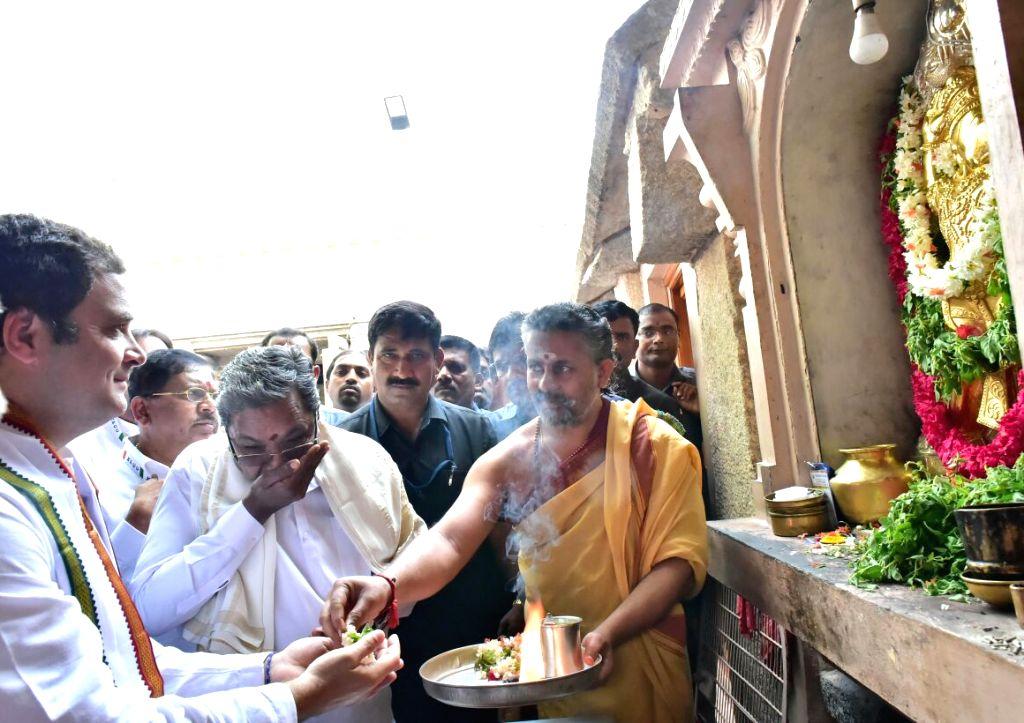 Congress President Rahul Gandhi along with Karnataka Chief Minister Siddaramaiah, visits Chamundeshwari Temple during Jan Ashirwad Yatra in Mysuru on March 24, 2018. - Siddaramaiah and Rahul Gandhi