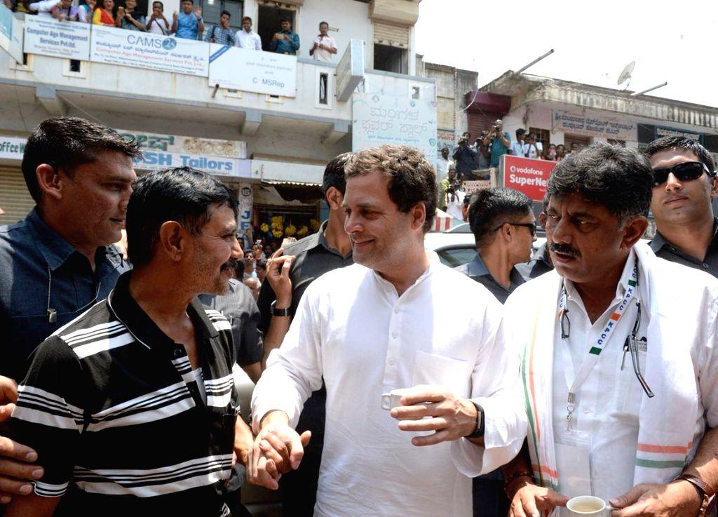 "Congress President Rahul Gandhi along with Karnataka Power minister D.K. Shivakumar, meets supporters during ""Janashirvada Rally"" in Karnataka's Davanagere on April 4, 2018. - D. and Rahul Gandhi"