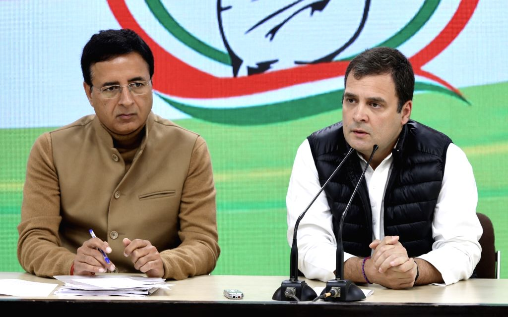 Congress President Rahul Gandhi along with party spokesperson Randeep Singh Surjewala addresses a press conference in New Delhi, on March 7, 2019. - Rahul Gandhi and Randeep Singh Surjewala