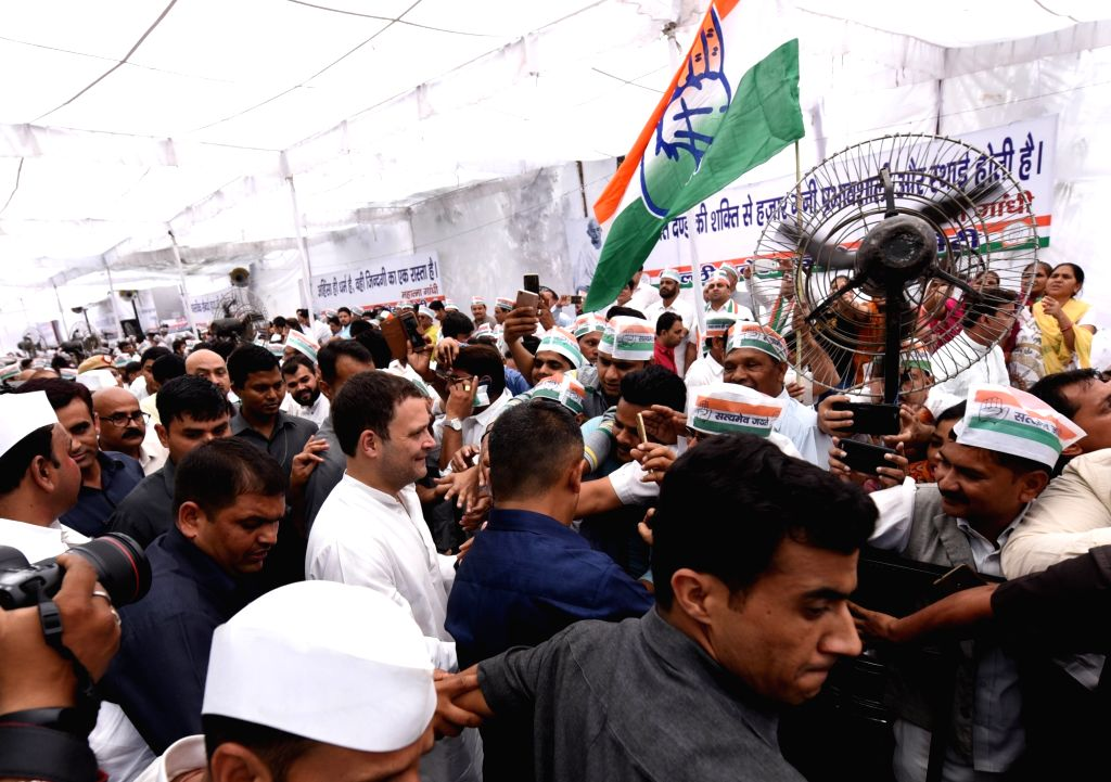 Congress President Rahul Gandhi being greeted by party workers on his arrival at the Congress' day-long hunger-strike organised to highlight alleged atrocities against Dalits, tribes and ... - Rahul Gandhi