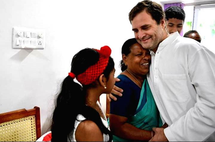 Congress President Rahul Gandhi hugged Rajamma, who was his delivery nurse at a hospital in Delhi way back in 1970. - Rahul Gandhi