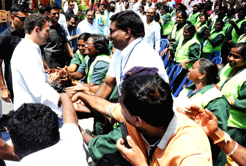 "Congress President Rahul Gandhi interacts with Bruhat Bengaluru Mahanagara Palike (BBMP) sanitation workers during ""Janashirvada Rally"", in Bengaluru on April 8, 2018. - Rahul Gandhi"