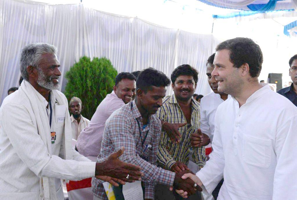 "Congress President Rahul Gandhi lunches with Karnataka Chief Minister Siddaramaiah during ""Janashirvada Rally"" in Karnataka's Davanagere on April 4, 2018. - Siddaramaiah and Rahul Gandhi"