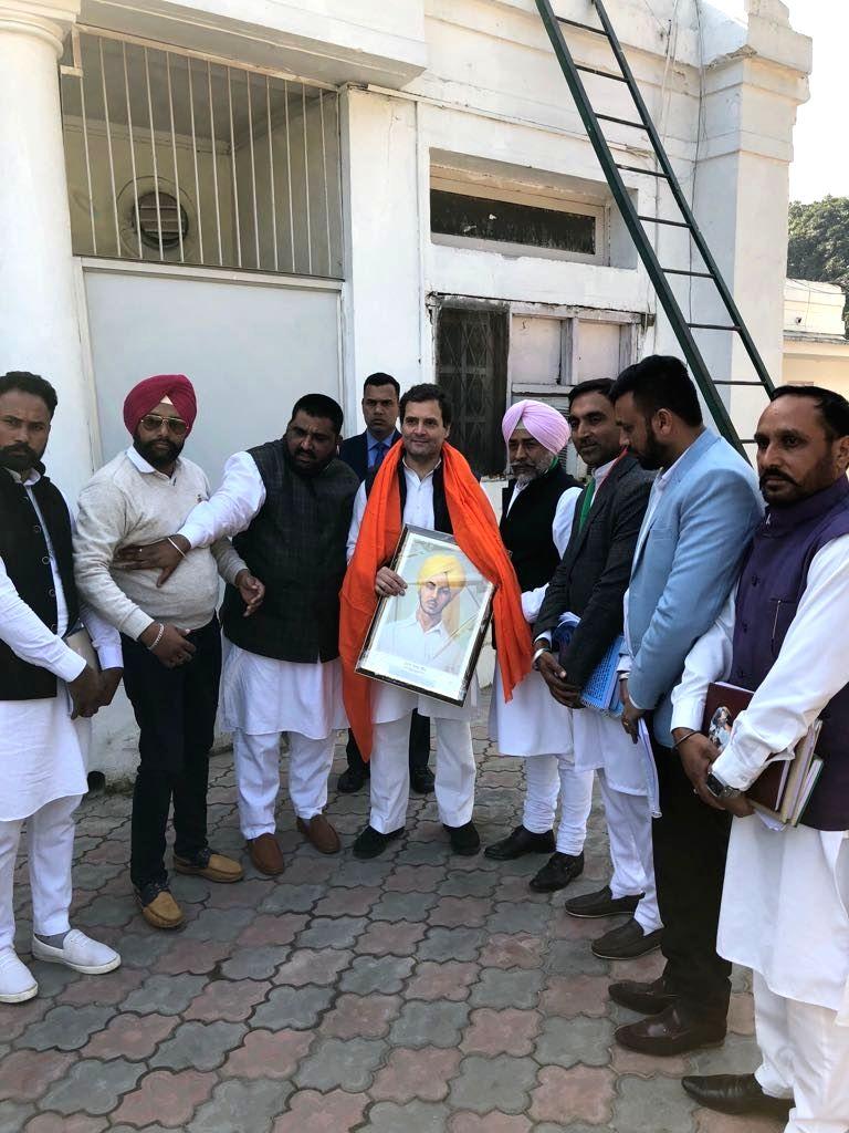 Congress president Rahul Gandhi meeting supporters at AICC headquarter in New Delhi on Feb. 7, 2018. - Rahul Gandhi