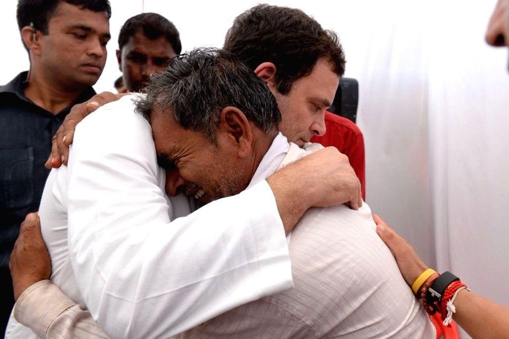 Congress President Rahul Gandhi meets the family members of the farmers killed in police firing last year, in Madhya Pradesh's Mandsaur on June 6, 2018. - Rahul Gandhi