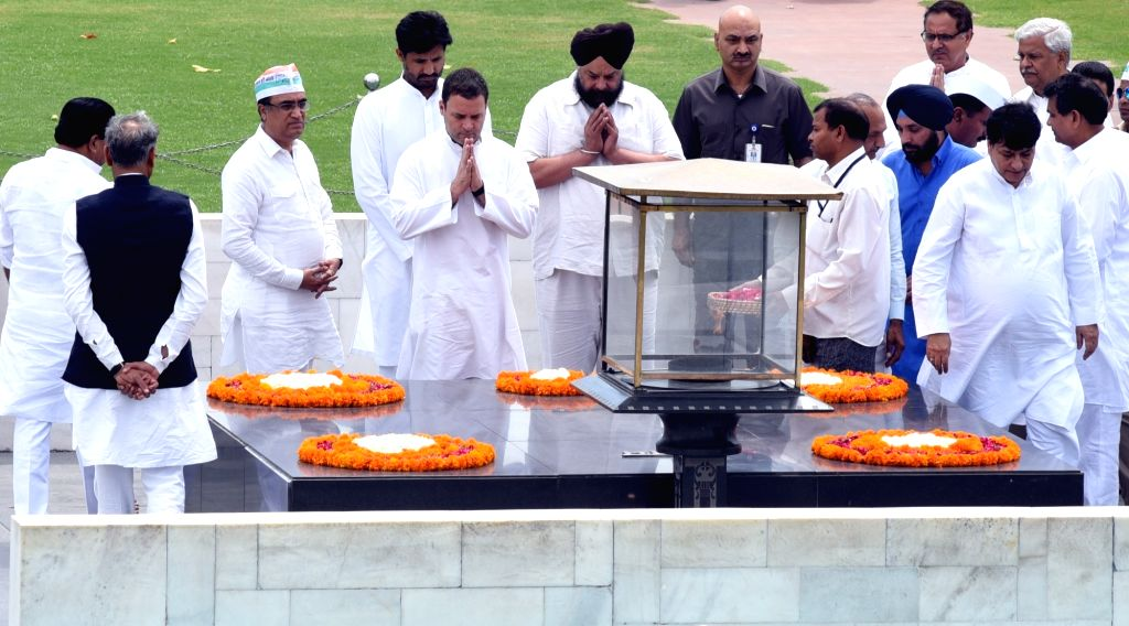 Congress President Rahul Gandhi pays homage at the Samadhi of Mahatma Gandhi during the Congress' day-long hunger-strike organised to highlight alleged atrocities against Dalits, tribes ... - Rahul Gandhi