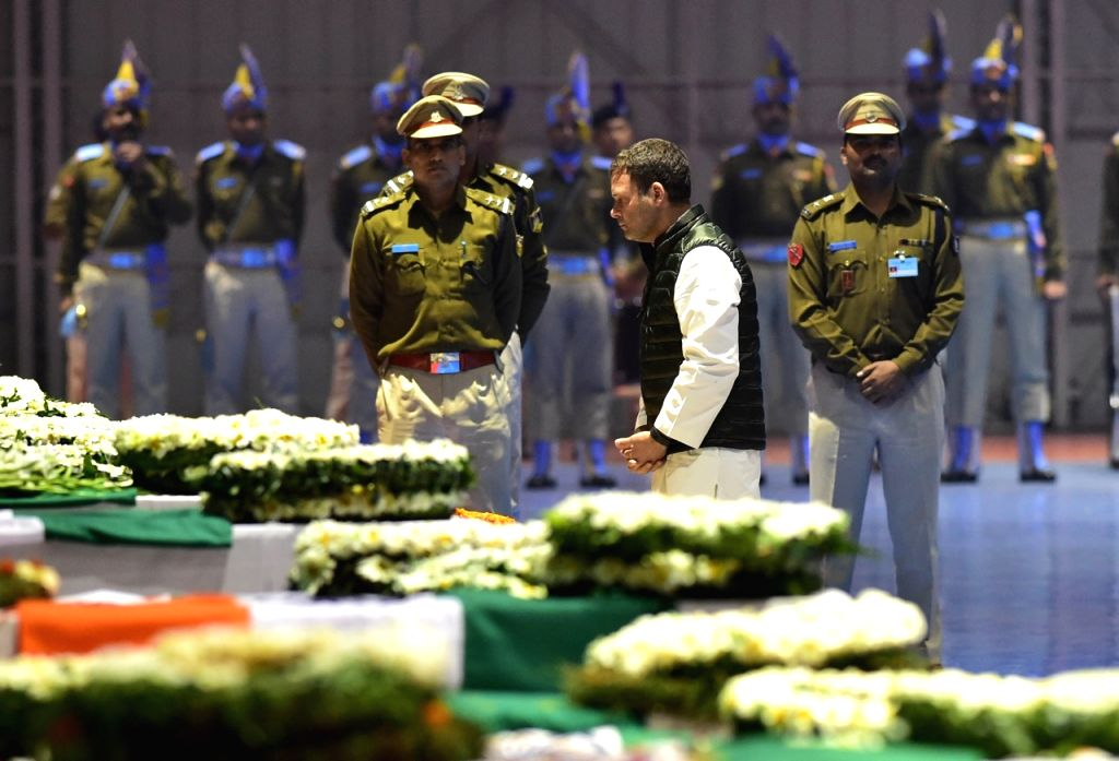 Congress President Rahul Gandhi pays tribute to CRPF personnel who were killed in a suicide attack by militants in Jammu and Kashmir's Pulwama district on 14th Feb 2019; at Palam Airport ... - Rahul Gandhi