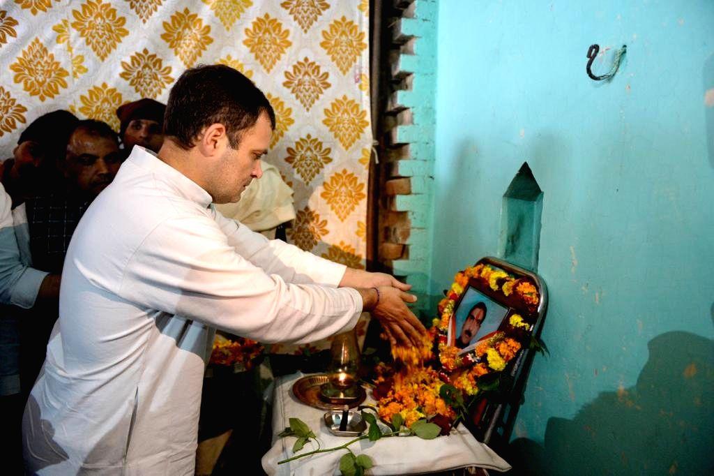 Congress President Rahul Gandhi pays tribute to martyr Pradeep Kumar, one of the 40 CRPF personnel killed in 14 Feb Pulwama militant attack; in Uttar Pradesh's Shamli district, on Feb 20, ... - Rahul Gandhi and Pradeep Kumar