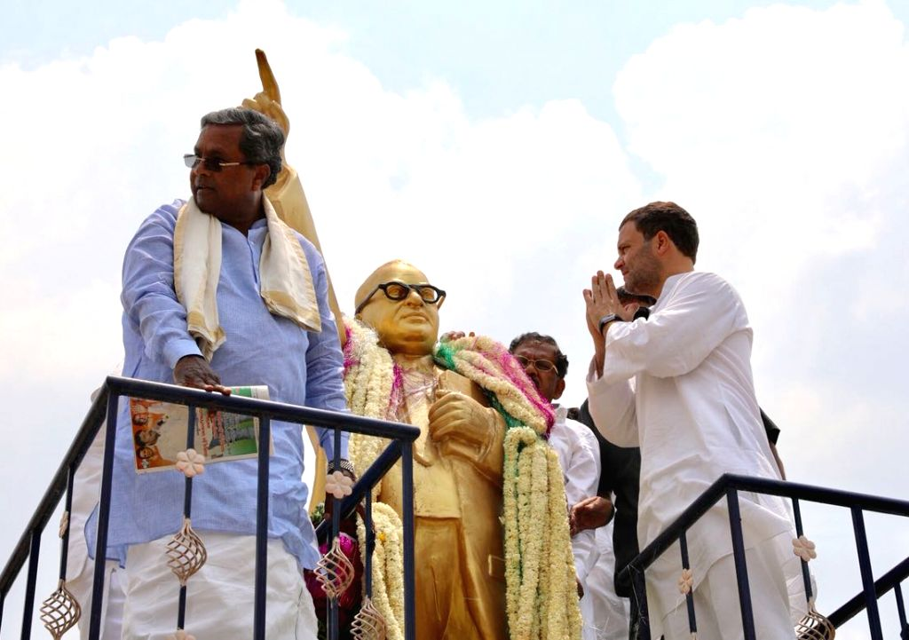 """Congress President Rahul Gandhi pays tributes to Dr. Babasaheb Ambedkar during a roadshow in Karnataka's Mulbagal during """"Janashirvada Rally"""" on April 7, 2018. - Rahul Gandhi"""