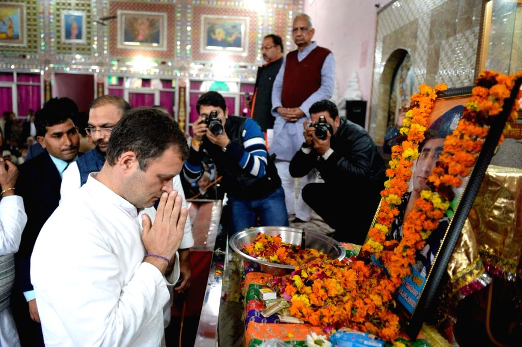 Congress President Rahul Gandhi pays tributes to martyr Amit Kumar Kori, one of the 40 CRPF personnel killed in 14 Feb Pulwama militant attack; in Uttar Pradesh's Shamli district, on Feb 20, ... - Rahul Gandhi and Amit Kumar Kori