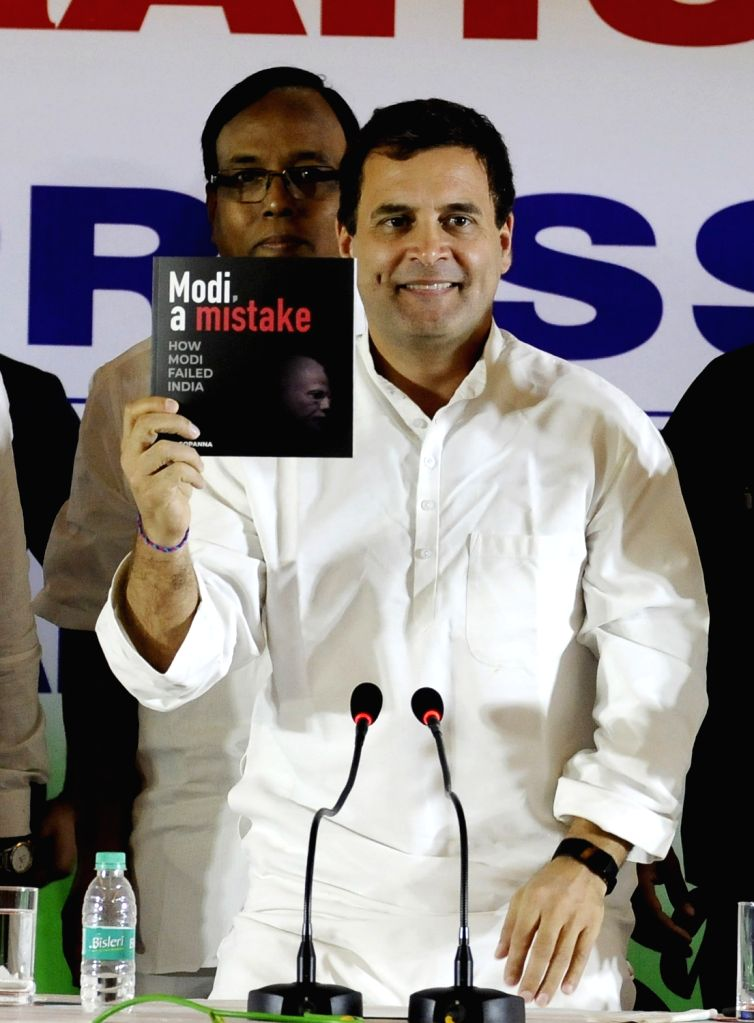 """Congress President Rahul Gandhi releases the book """"Modi, A Mistake"""" during a press conference in Chennai, on March 13, 2019. - Rahul Gandhi"""