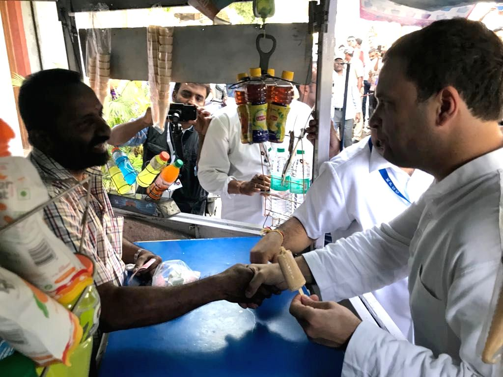 Congress President Rahul Gandhi shakes hands with an ice-cream seller in Bengaluru, on April 8, 2018. - Rahul Gandhi