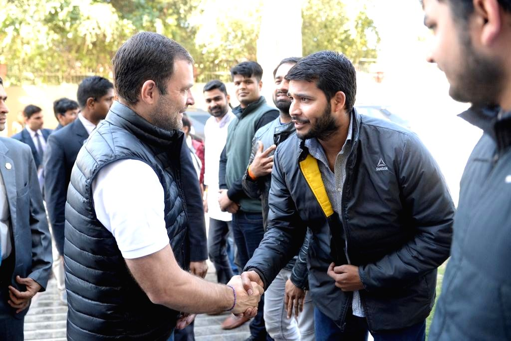 Congress President Rahul Gandhi shakes hands with students during a party programme at Jawaharlal Nehru Stadium in New Delhi on Feb 23, 2019. - Rahul Gandhi