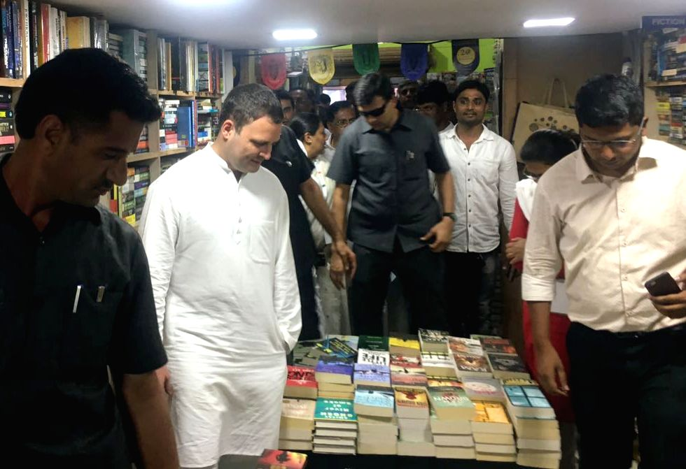 "Congress President Rahul Gandhi visits a book store during ""Janashirvadha Yatra"", in Bengaluru on April 8, 2018. - Rahul Gandhi"
