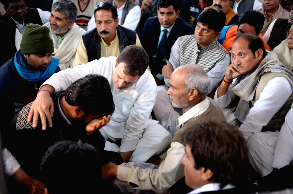 Congress President Rahul Gandhi visits the grief struck family members of martyr Amit Kumar Kori, one of the 40 CRPF personnel killed in 14 Feb Pulwama militant attack; in Uttar Pradesh's ... - Rahul Gandhi and Amit Kumar Kori