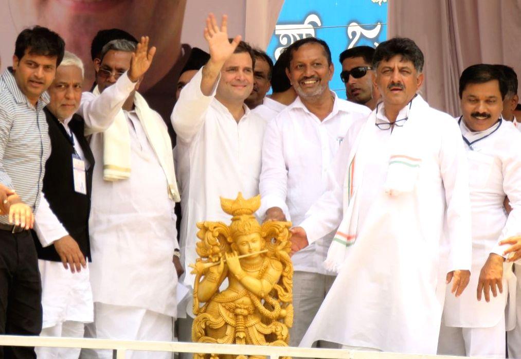 Congress President Rahul Gandhi with Karnataka Chief Minister Siddaramaiah during a road show in Shimoga, Karnataka on April 3, 2018. - Siddaramaiah and Rahul Gandhi